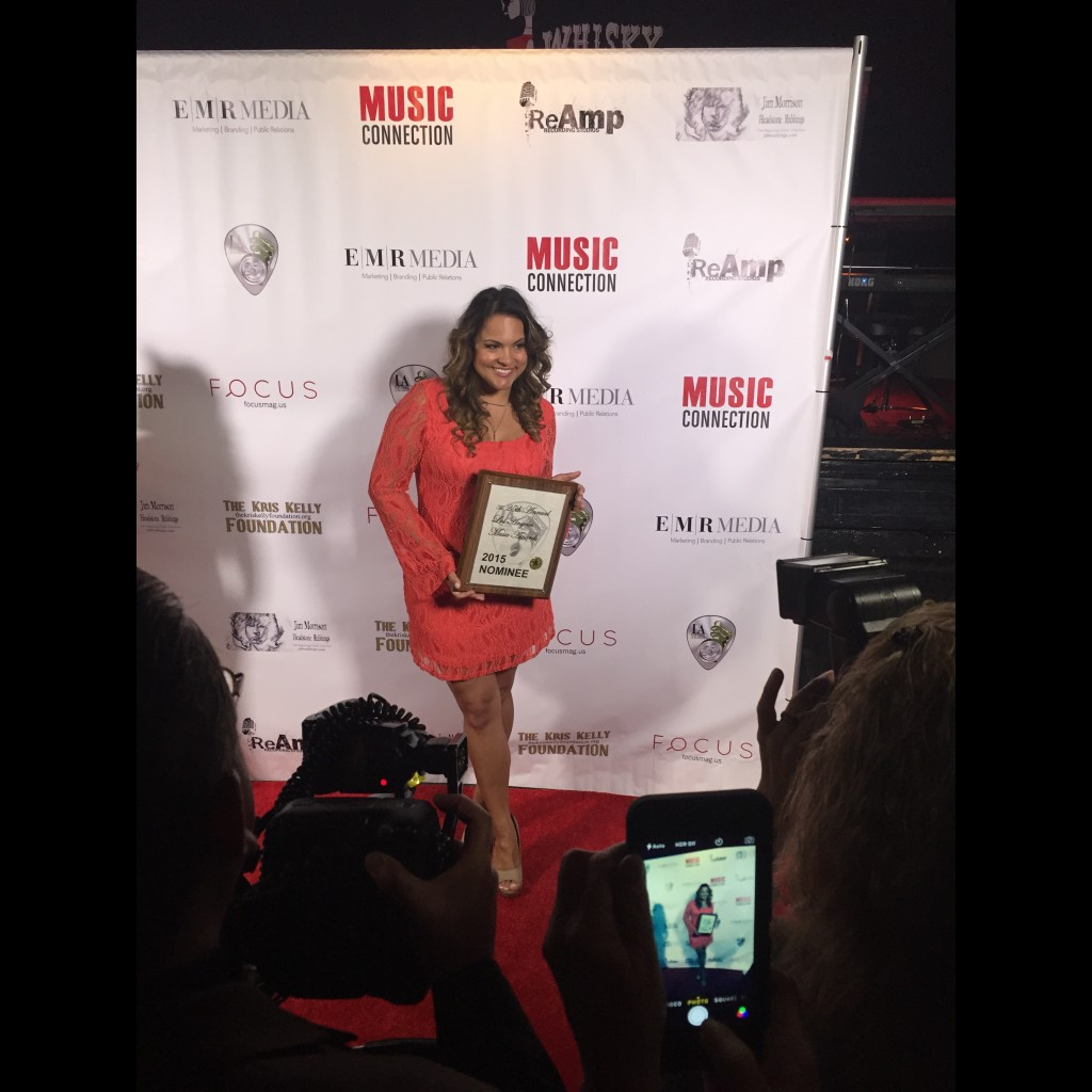 Joanna on red carpet with 2015 nominee plaque